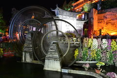 Water wheel ,the landmark of Lijiang Dayan old town at night Stock Image