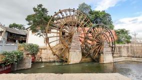 Water wheel in Lijiang old town ,Yunnan China. Stock Photos