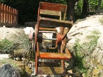 Water wheel. The water wheel rotates the flowing stream at Vlkolinec stock video