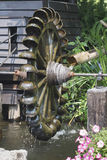 Water wheel turbine. The use falling water to create power Royalty Free Stock Photography