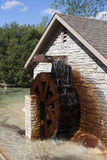 Water Wheel turning Stock Images