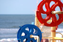 Water Wheels. A depth of field shot of colorful, plastic water-wheels with water running over the red wheel and splattering onto the blue wheel, in front of an Stock Photography