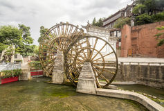 Water wheels in old town of Lijiang , Yunnan China. Royalty Free Stock Images