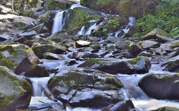 Water which flows at rocks Royalty Free Stock Image