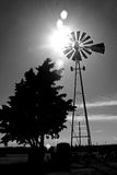 Water windmill. On a hot summer day on a West Texas ranch, near Lubbock, USA with intentional sun flare Stock Photography
