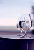 Water in the wine glass on background Stock Images