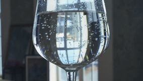 Water in the wineglass stock footage