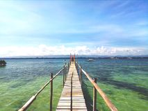 Water wooden bridge of fish sanctuary. A water wooden bridge or known to locals as boulevard, that connects to a floating resto in a fish sanctuary of the island Stock Photo