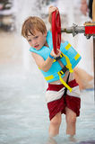 Water works. Little boy playing in water Stock Images