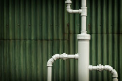 Water works pipes in front of grunge background Stock Image
