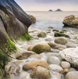 Water worn ancient rocks detail on beach Stock Photography