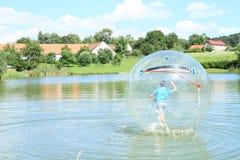 Water-zorbing boy Royalty Free Stock Image