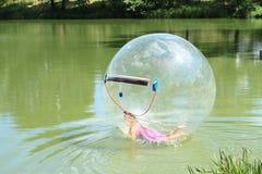 Water-zorbing girl Royalty Free Stock Image
