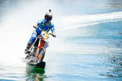 WaterBike ride by Robbie Maddison Australian stunt rider, the image shows how to ride his dirt bike on water in action. A SYDNEY, AUSTRALIA. – On November 25 Royalty Free Stock Image