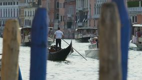 Waterbuses and gondolas sailing with tourists aboard across channel in Venice. Stock footage stock video footage