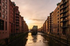 Watercastle in old warehouse district in Hamburg in the evening with ice sheets on Elbe River. stock image