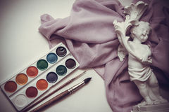 Waterciolor paints on drapery with brushes Stock Photography