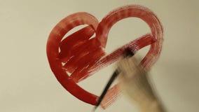 Watercolor που χρωματίζει την κόκκινη ευχετήρια κάρτα καρδιών για την ημέρα βαλεντίνων ` s φιλμ μικρού μήκους