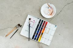 Watercolor aquarelle paints in box with palette.  royalty free stock photos