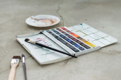 Watercolor aquarelle paints in box with palette.  royalty free stock image