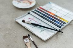 Watercolor aquarelle paints in box with palette.  stock photo