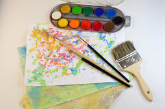 Watercolor art and brushes stock images