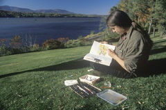 A watercolor artist painting. On the Hudson River, Claremont State Park,NY royalty free stock images