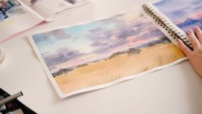 Watercolor artwork landscape painter sketchbook. Watercolor artwork. Nature landscape. Female painter turning pages of sketchbook. Artist talent creativity stock footage