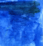 Watercolor background. Blue watercolor background. Scanned paper with blue paint on it Royalty Free Stock Photography