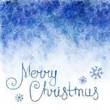 Watercolor background. Sky with falling snowflakes and text Merry Christmas Royalty Free Stock Images