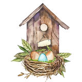 Watercolor birdhouse with Spring flowers, eggs. Hand painted nesting box isolated on white background. Easter design. Watercolor birdhouse with Spring flowers Stock Images
