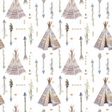 Watercolor boho seamless pattern with teepee, arrows, feathers. Royalty Free Stock Photography