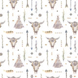Watercolor boho seamless pattern with teepee, arrows, feathers. Stock Image