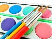 Watercolor box and paintbrushes Royalty Free Stock Image