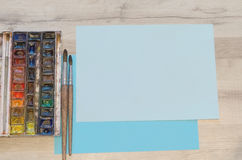 Watercolor box and paper Royalty Free Stock Image
