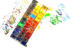 Watercolor in a box. Watercolor in a box on white background Royalty Free Stock Photos