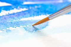Watercolor brush. Paint brush on the paper with watercolor painting Stock Photography