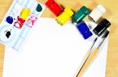 Watercolor brushes, art paper board. Watercolor brushes, art paper board on wood background Stock Photos