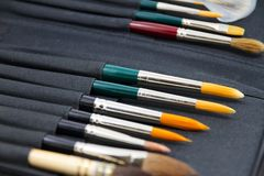 Watercolor brushes in Case Royalty Free Stock Photos
