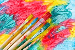 Watercolor brushes and colorful painting Stock Photo