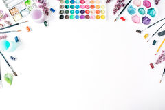 Watercolor and brushes at white background