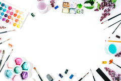 Watercolor and brushes at white background Stock Images