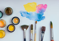 Watercolor and brushes on white background Stock Photo