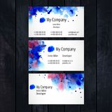 Watercolor business card template. On dark wooden background Royalty Free Stock Photography