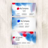 Watercolor business card template. On light wooden background Stock Image