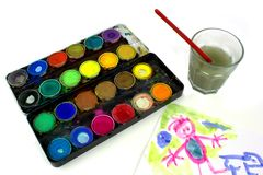 Watercolor and child painting Royalty Free Stock Photos