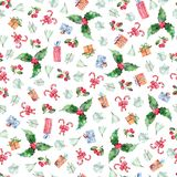 Watercolor Christmas seamless pattern with berries, holly flowers and gifts on white background stock photo