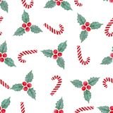 Watercolor Christmas seamless pattern with mistletoe and candy canes . Can be used for wrapping and fabric design. Royalty Free Stock Photo