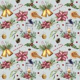 Watercolor Christmas seamless pattern with traditional decor. Hand painted lantern, snowberry, bells, candle, mistletoe Royalty Free Stock Photography