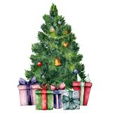 Watercolor Christmas tree with toys and gifts. Hand painted New Year tree with toys and lights, gift boxes with bow. Isolated on white background. Holiday stock illustration